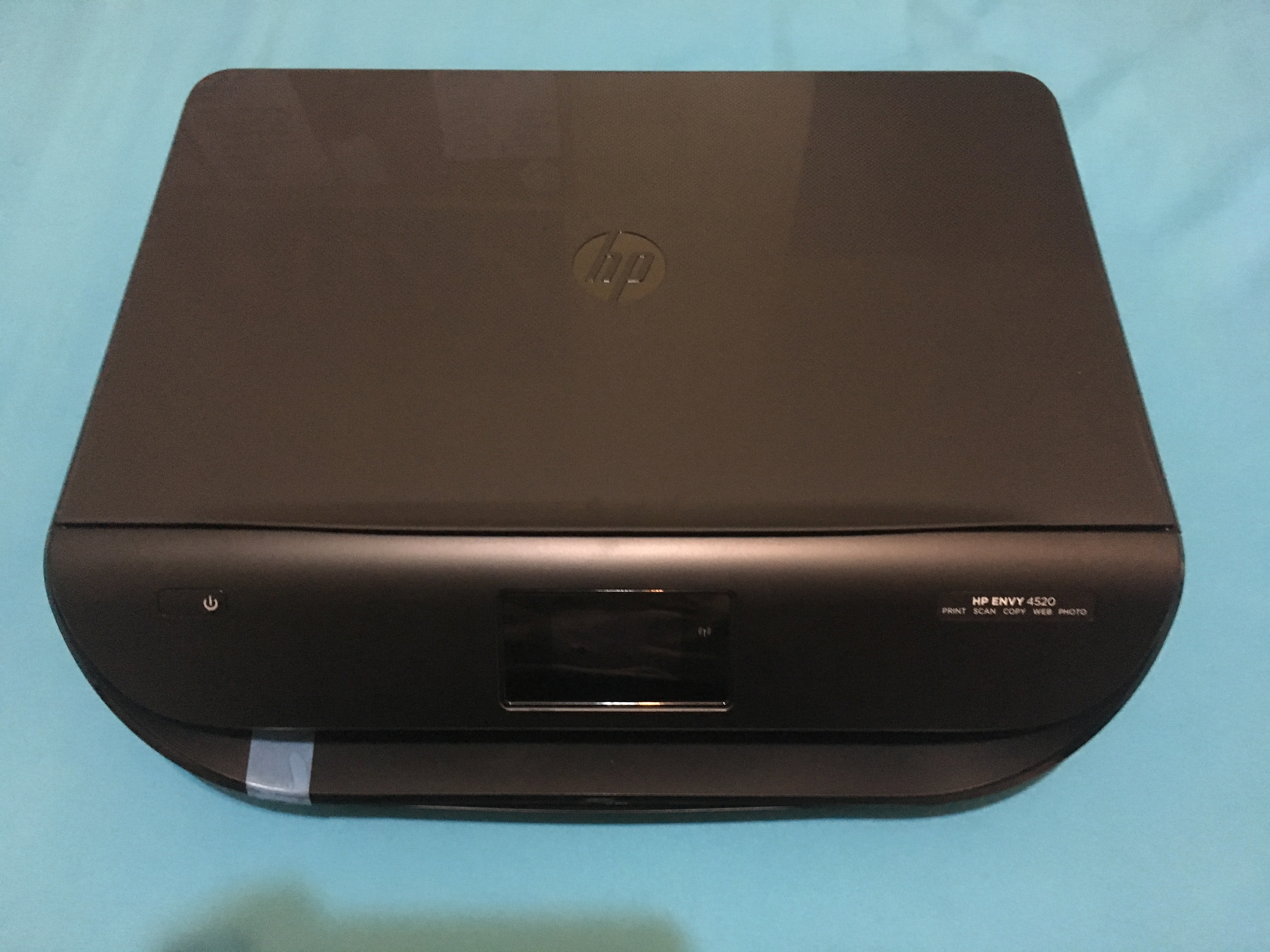 how to open hp envy 4520 printer